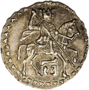 silver coin with man on horse