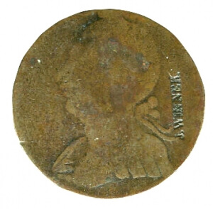 heavily worn colonial era copper coin with countermark