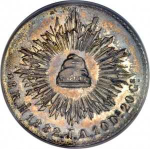 coin with liberty cap surrounded by rays