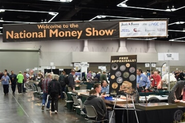welcome the national money show banner with a wide shot of the show