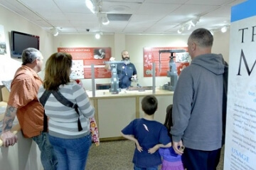 young numismatists watching a demonstration at the money museum