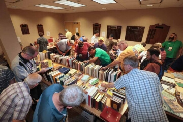 room full of people looking at books on shelves