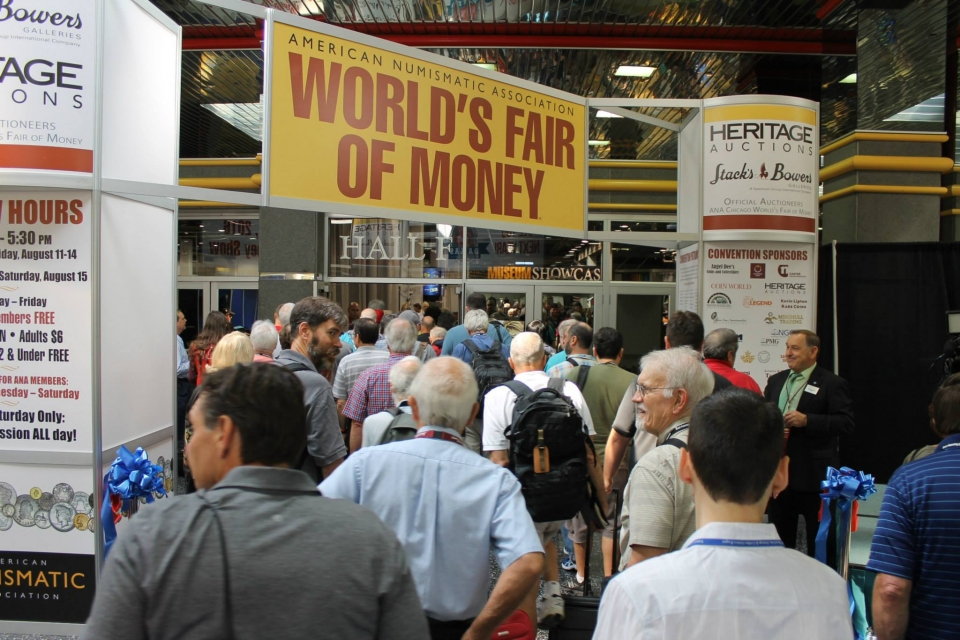 world's fair of money banner over crowd of people entering bourse floor
