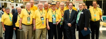 group of men in matching yellow shirts