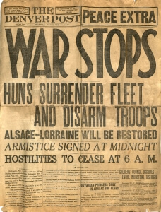 "old newspaper with headline ""war stops"""