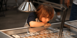 young coin collector at coin show