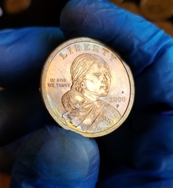 End coin from Sacagawea Mint roll, notice how you can see how the Mint's paper crimping left a p